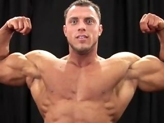 Scruffy Bodybuilder Backstage Posing