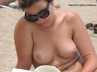 Beauty Woman Bare-chested On The Beach