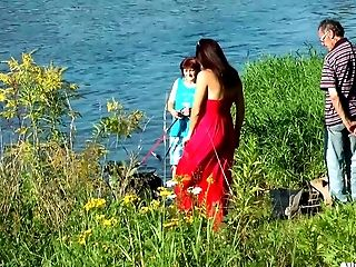 Cleavage Bearing Stunner In A Crimson Sundress Playing In The Water