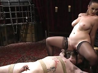 Domina Puts Strap-on On Admirer's Face For Railing
