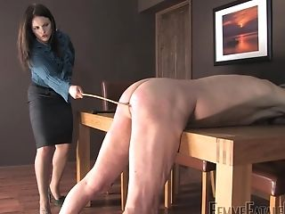 Mistress Lola Spanks Her Submissive And Coerces Him To Gobble Her Feet