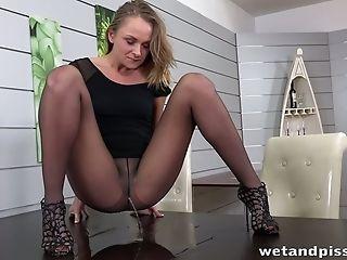 Horny Blonde Bimbo Urinates Thru The Groin Of Her Pantyhose