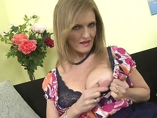 Matures Blonde Granny Raina W. Plays With Her Saggy Tits On The Couch