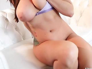 Alison Tyler Thumbs Her Honeypot On The Couch