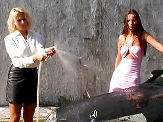 Startling Xena And Claudia Rossi Taking Turns Hosing Each Other Down.